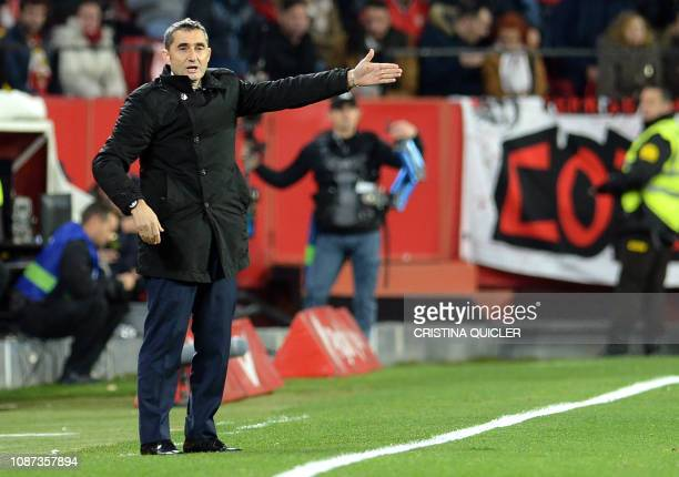 Barcelona's Spanish coach Ernesto Valverde gestures during the Spanish Copa del Rey quarterfinal first leg football match between Sevilla FC and FC...