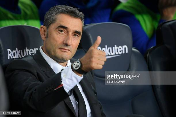 Barcelona's Spanish coach Ernesto Valverde gives a thumbs-up before the Spanish league football match between FC Barcelona and Real Valladolid FC at...