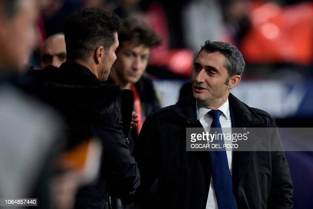 Barcelona's Spanish coach Ernesto Valverde greets Atletico Madrid's Argentinian coach Diego Simeone before the Spanish league football match between...
