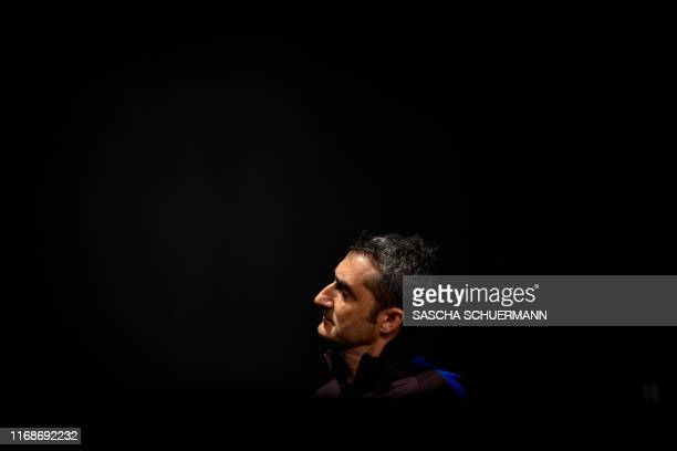 Barcelona's Spanish coach Ernesto Valverde leaves after a press conference on the eve of the UEFA Champions League Group F football match between...