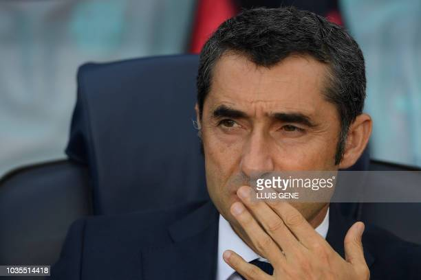 Barcelona's Spanish coach Ernesto Valverde looks on before the UEFA Champions' League group B football match FC Barcelona against PSV Eindhoven at...
