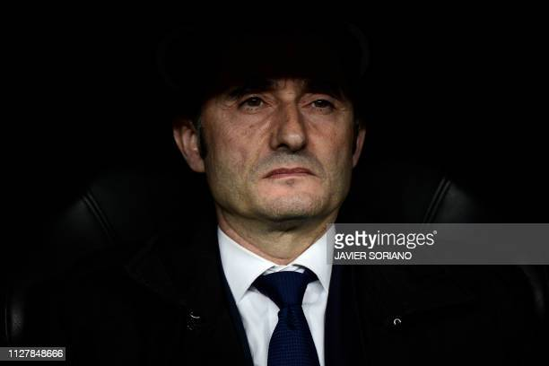 Barcelona's Spanish coach Ernesto Valverde looks on during the Spanish Copa del Rey semifinal second leg football match between Real Madrid and...