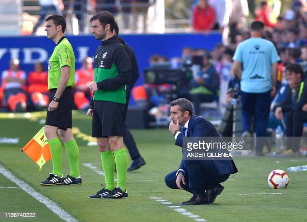 Barcelona's Spanish coach Ernesto Valverde looks on during the Spanish league football match between SD Huesca and FC Barcelona at the El Alcoraz...