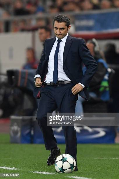 Barcelona's Spanish coach Ernesto Valverde reacts during the UEFA Champions League group D football match between FC Barcelona and Olympiakos FC at...