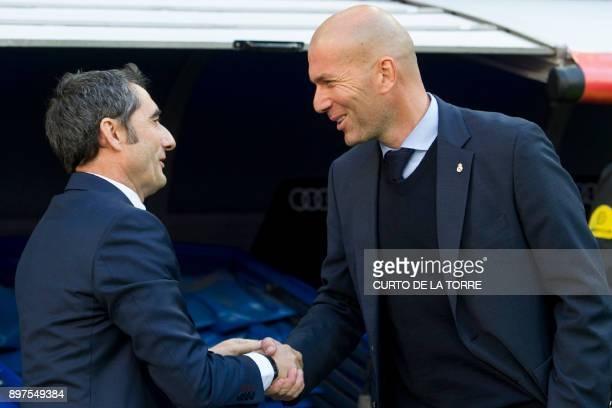 Barcelona's Spanish coach Ernesto Valverde shakes hands with Real Madrid's French coach Zinedine Zidane before the Spanish League Clasico football...