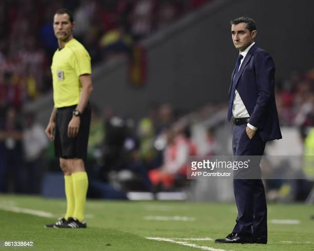 Barcelona's Spanish coach Ernesto Valverde stands on the sideline during the Spanish league football match Club Atletico de Madrid vs FC Barcelona at...