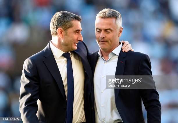Barcelona's Spanish coach Ernesto Valverde talks with Celta Vigo's Spanish coach Fran Escriba before the Spanish league football match between RC...