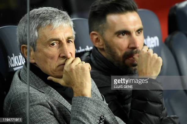 Barcelona's Spanish coach Quique Setien and coaching assistant Eder Sarabia sit on the benche before the Spanish league football match between FC...