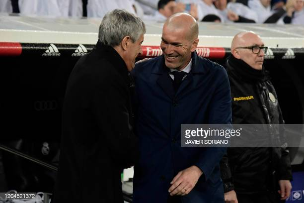 Barcelona's Spanish coach Quique Setien and Real Madrid's French coach Zinedine Zidane greet each other before the Spanish League football match...