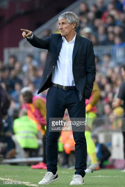 Barcelona's Spanish coach Quique Setien gestures during the Spanish league football match between FC Barcelona and Getafe CF at the Camp Nou stadium...
