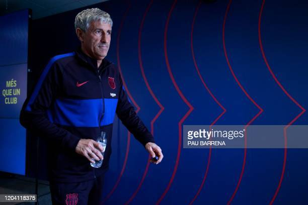 Barcelona's Spanish coach Quique Setien leaves after a press conference at the Joan Gamper training ground in Sant Joan Despi in the outskirts of...