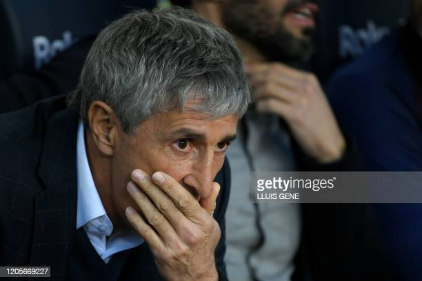 Barcelona's Spanish coach Quique Setien looks on before the Spanish league football match between FC Barcelona and Real Sociedad at the Camp Nou...