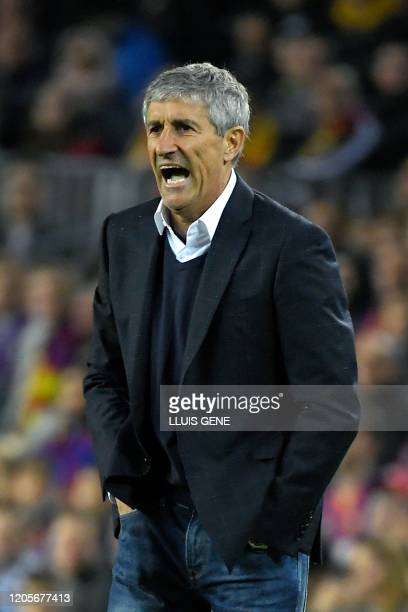 Barcelona's Spanish coach Quique Setien reacts during the Spanish league football match between FC Barcelona and Real Sociedad at the Camp Nou...
