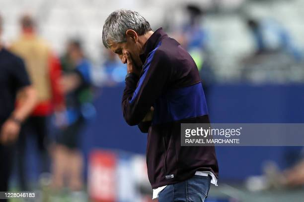 TOPSHOT Barcelona's Spanish coach Quique Setien reacts during the UEFA Champions League quarterfinal football match between Barcelona and Bayern...