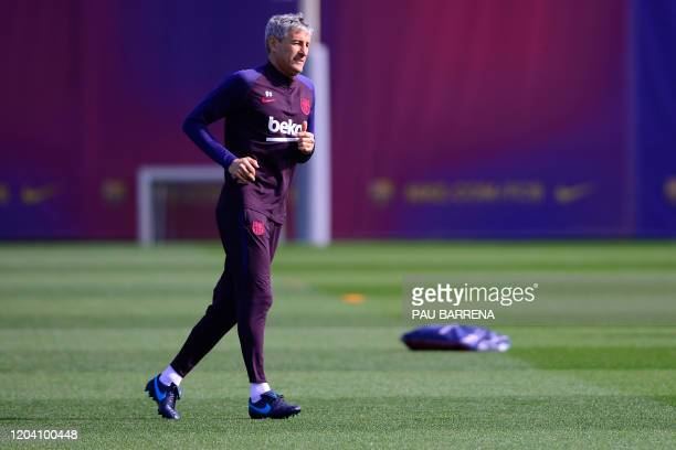 Barcelona's Spanish coach Quique Setien runs during a training session at the Joan Gamper training ground in Sant Joan Despi in the outskirts of...