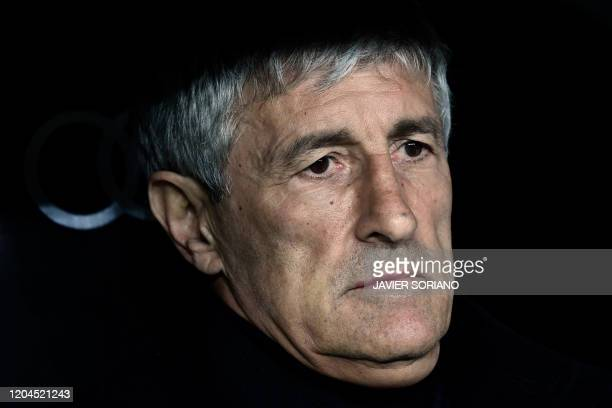Barcelona's Spanish coach Quique Setien sits on the bench before the Spanish League football match between Real Madrid and Barcelona at the Santiago...