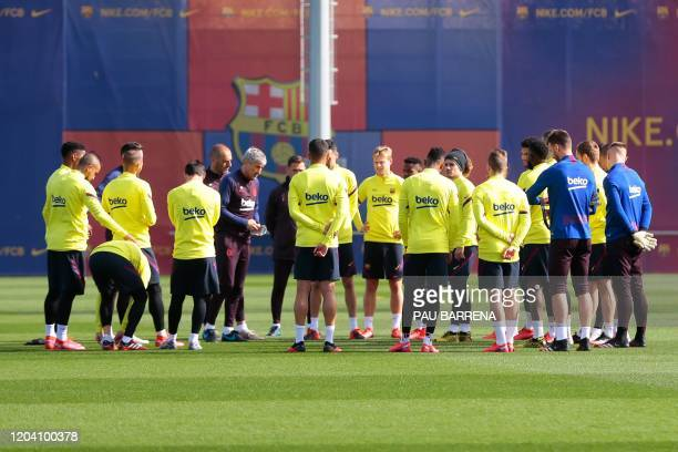 Barcelona's Spanish coach Quique Setien speaks to players during a training session at the Joan Gamper training ground in Sant Joan Despi in the...