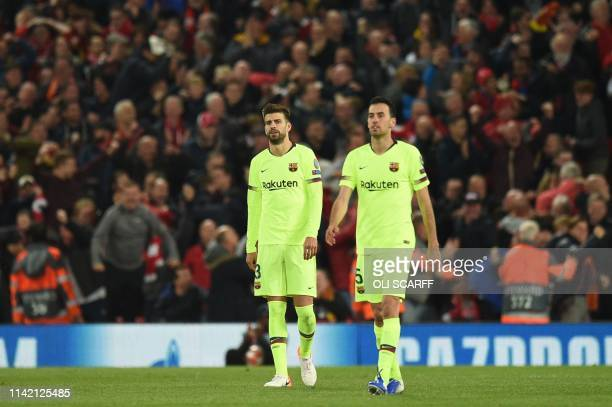 Barcelona's Spanish defender Gerard Pique and Barcelona's Spanish midfielder Sergio Busquets react after Liverpool scored their third goal during the...