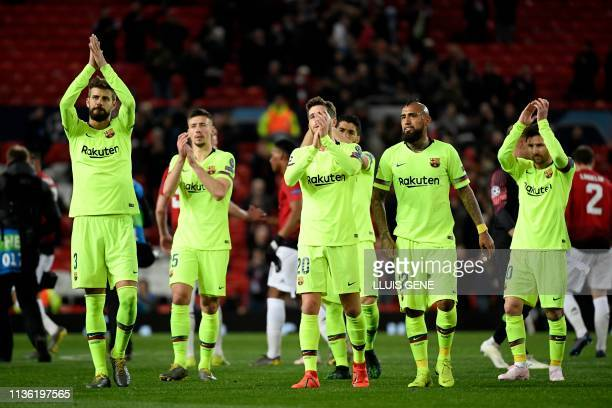 Barcelona's Spanish defender Gerard Pique applauds fans after winning the UEFA Champions league first leg quarter-final football match between...