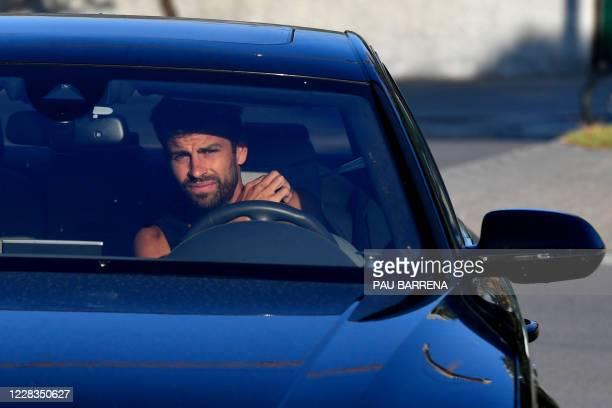 Barcelona's Spanish defender Gerard Pique arrives at the Joan Gamper Ciutat Esportiva in Sant Joan Despi near Barcelona for a training session on...