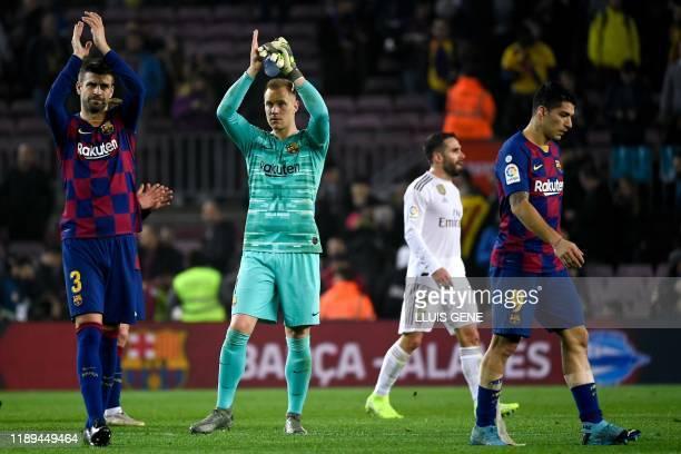 Barcelona's Spanish defender Gerard Pique , Barcelona's German goalkeeper Marc-Andre Ter Stegen and Barcelona's Uruguayan forward Luis Suarez leave...
