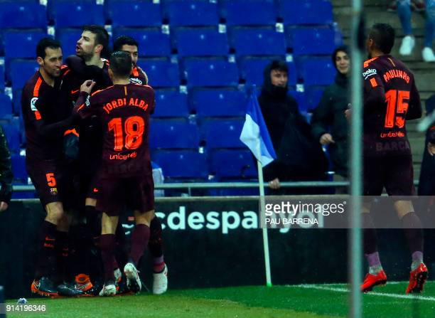 Barcelona's Spanish defender Gerard Pique celebrates a gola with teammates during the Spanish league football match between RCD Espanyol and FC...