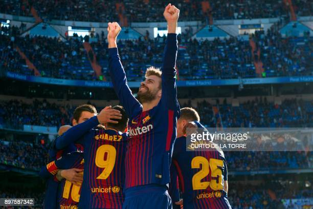 TOPSHOT Barcelona's Spanish defender Gerard Pique celebrates after Barcelona's Spanish midfielder Aleix Vidal scored during the Spanish League...