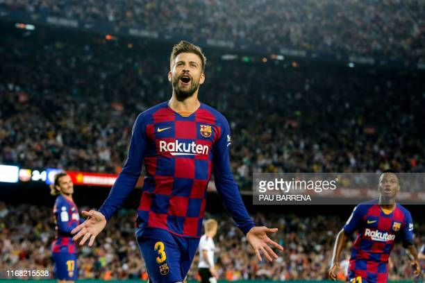 Barcelona's Spanish defender Gerard Pique celebrates after scoring a goal during the Spanish league football match FC Barcelona against Valencia CF...