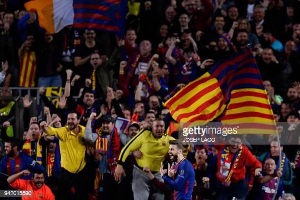 Barcelona's Spanish defender Gerard Pique celebrates after scoring a goal during the UEFA Champions League quarterfinal first leg football match...
