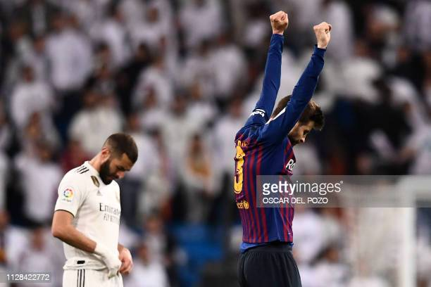 Barcelona's Spanish defender Gerard Pique celebrates during the Spanish league football match between Real Madrid CF and FC Barcelona at the Santiago...