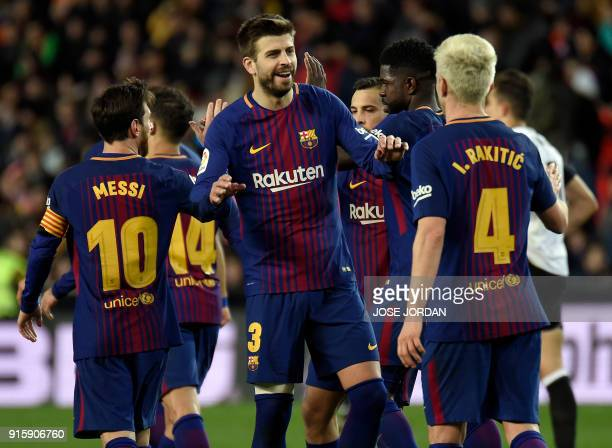 Barcelona's Spanish defender Gerard Pique congratulates Barcelona's Croatian midfielder Ivan Rakitic for his goal during the Spanish 'Copa del Rey'...