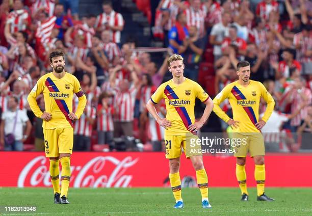 TOPSHOT Barcelona's Spanish defender Gerard Pique Dutch midfielder Frenkie de Jong and French defender Clement Lenglet react to Athletic's goal...
