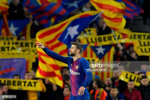 Barcelona's Spanish defender Gerard Pique gestures during the Spanish league football match between FC Barcelona and Girona FC at the Camp Nou...