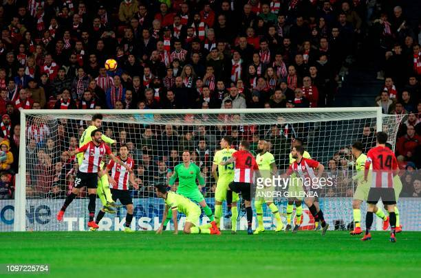 Barcelona's Spanish defender Gerard Pique jumps for the ball with Athletic Bilbao's Spanish midfielder Raul Garcia during the Spanish league football...