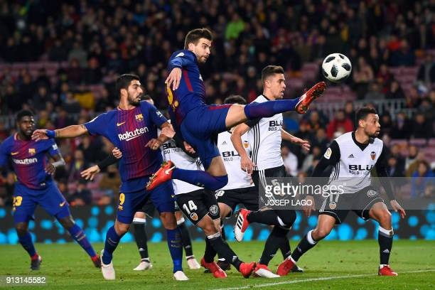 TOPSHOT Barcelona's Spanish defender Gerard Pique kicks the ball during the Spanish 'Copa del Rey' first leg semifinal football match between FC...