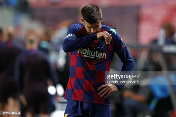 Barcelona's Spanish defender Gerard Pique reacts at the end of the UEFA Champions League quarter-final football match between Barcelona and Bayern...