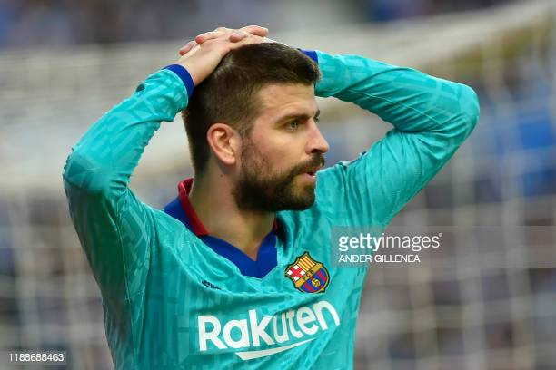 Barcelona's Spanish defender Gerard Pique reacts during the Spanish league football match between Real Sociedad and FC Barcelona at Anoeta stadium in...