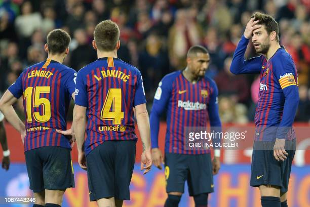 Barcelona's Spanish defender Gerard Pique reacts to Sevilla's goal during the Spanish Copa del Rey quarterfinal first leg football match between...
