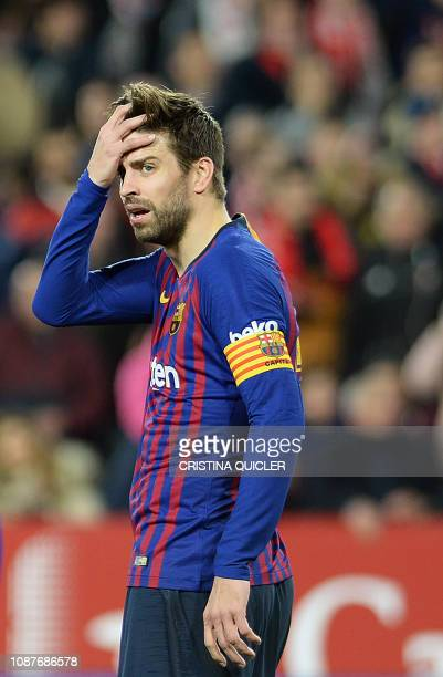 Barcelona's Spanish defender Gerard Pique reacts to Sevilla's second goal during the Spanish Copa del Rey quarterfinal first leg football match...