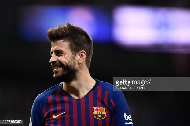 TOPSHOT Barcelona's Spanish defender Gerard Pique smiles during the Spanish Copa del Rey semifinal second leg football match between Real Madrid and...