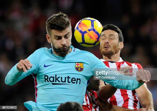 Barcelona's Spanish defender Gerard Pique vies with Athletic Bilbao's Spanish forward Aritz Aduriz during the Spanish league football match Athletic...