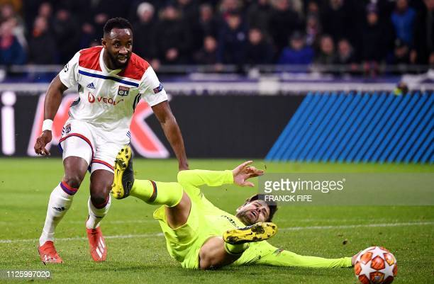 Barcelona's Spanish defender Gerrad Pique vies with Lyon's French forward Moussa Dembele during the UEFA Champions League round of 16 first leg...