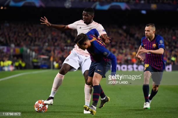 Barcelona's Spanish defender Jordi Alba and Barcelona's Brazilian midfielder Philippe Coutinho challenge Manchester United's French midfielder Paul...