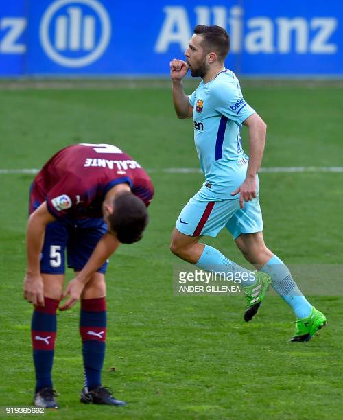 Barcelona's Spanish defender Jordi Alba celebrates after scoring his team's second goal during the Spanish league football match between SD Eibar and...