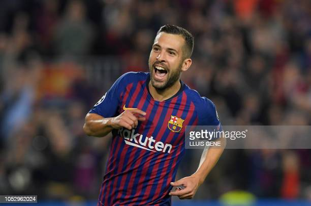 Barcelona's Spanish defender Jordi Alba celebrates after scoring during the UEFA Champions League group B match Barcelona against Inter Milan at the...