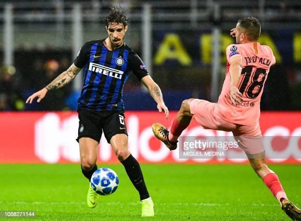 Barcelona's Spanish defender Jordi Alba defends against Inter Milan's Croatian defender Sime Vrsaljko during the UEFA Champions League group B...