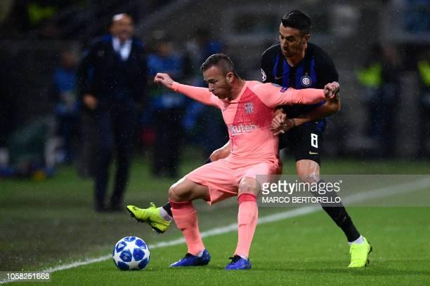 Barcelona's Spanish defender Jordi Alba holds off Inter Milan's Uruguayan midfielder Matias Vecino during the UEFA Champions League group B football...