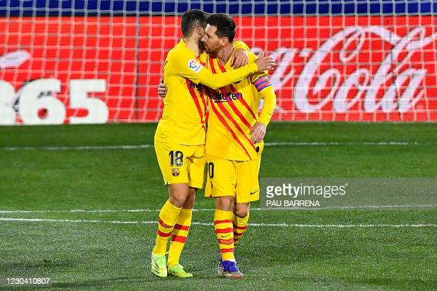 Barcelona's Spanish defender Jordi Alba hugs Barcelona's Argentinian forward Lionel Messi as they celebrate their team's goal during the Spanish...