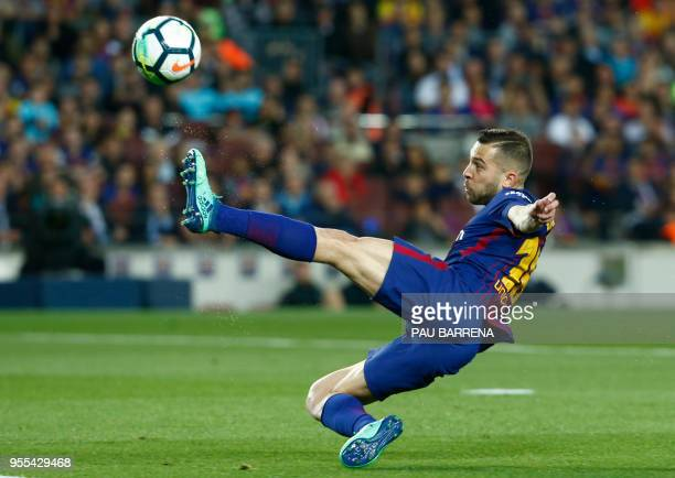 TOPSHOT Barcelona's Spanish defender Jordi Alba kicks the ball during the Spanish league football match between FC Barcelona and Real Madrid CF at...