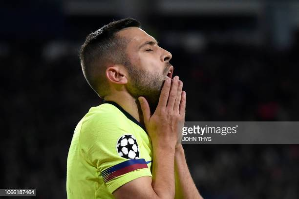 Barcelona's Spanish defender Jordi Alba reacts during the UEFA Champions League football match between PSV Eindhoven and FC Barcelona at Philips...